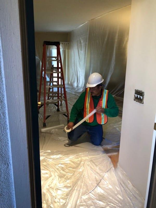 A repipe1 crew member at work in a home in Orange County, CA